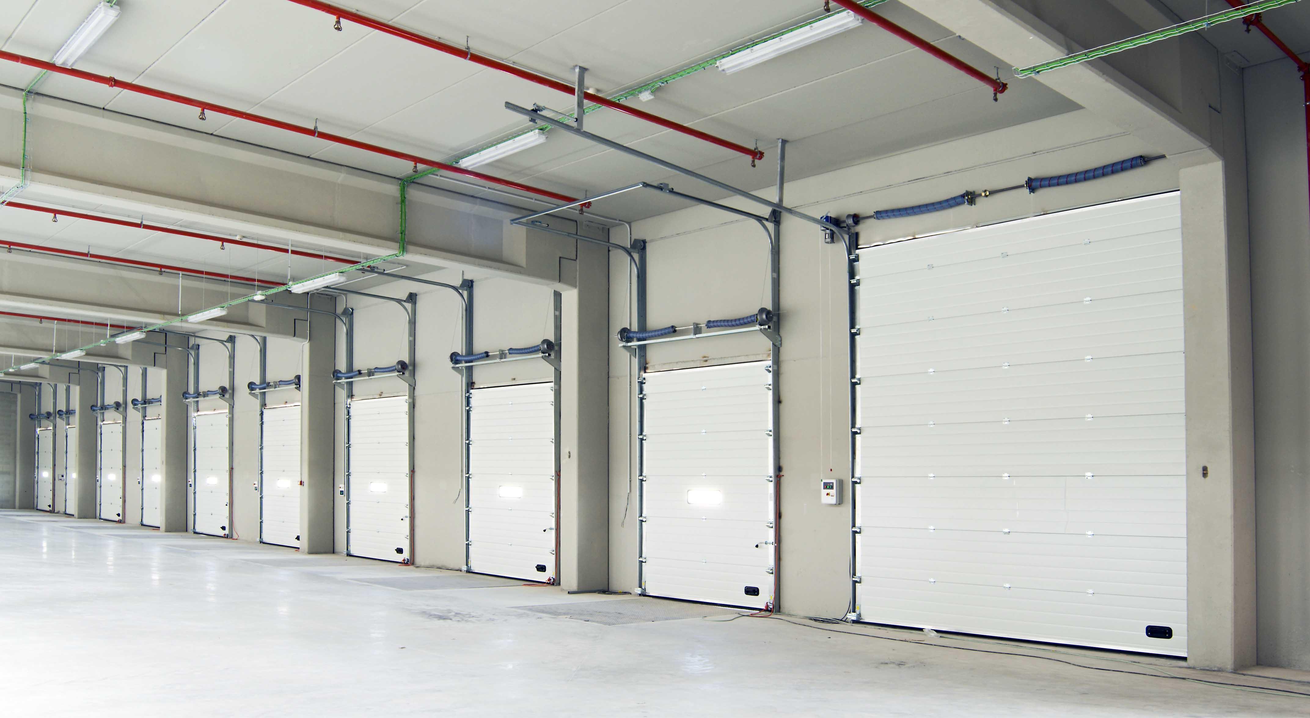 Puertas seccionales industriales portis for Puertas industriales